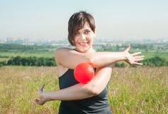 Beautiful woman exercising with ball Stock Photos