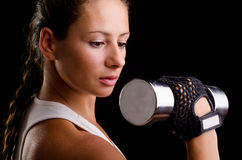 Beautiful woman exercising with dumbbells Royalty Free Stock Photography