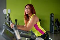 Beautiful woman exercising on an exercise bike Royalty Free Stock Image