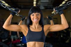 Beautiful woman exercising at the gym Royalty Free Stock Photos