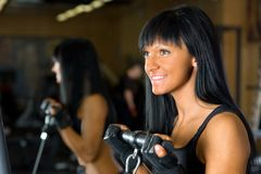 Beautiful woman exercising at the gym Stock Image