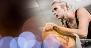 Beautiful woman exercising in gym. Digital composite of Beautiful woman exercising in gym Stock Images