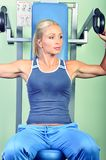 Beautiful woman exercising in a gym Royalty Free Stock Photography