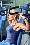 Beautiful woman exercising in a gym Stock Photography