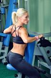 Beautiful woman exercising in a gym Stock Photos