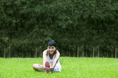 Beautiful woman exercising outdoors Stock Image