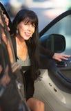 Beautiful Woman Exiting Vehicle Royalty Free Stock Photo
