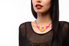 The beautiful woman in expensive necklace isolated Stock Image
