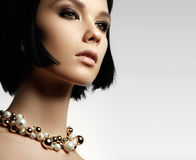 The beautiful woman in expensive pendant close-up. Beautiful you Stock Images