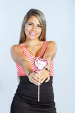Beautiful woman expressing love with balloon on white background Royalty Free Stock Images
