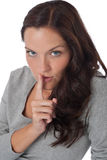 Beautiful woman expressing silence, finger on lips Royalty Free Stock Photos