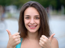 Beautiful Woman Expressing Success Thumbs Up Royalty Free Stock Photography