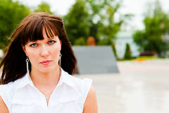 Beautiful woman with expressive eyes. Portrait of a woman in white Royalty Free Stock Images