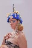 Beautiful woman with extravagant headdress Stock Image