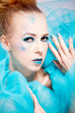 Beautiful woman with extreme colorfull make up in turquoise Stock Photography
