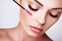 Beautiful woman with long false eyelashes royalty free stock image
