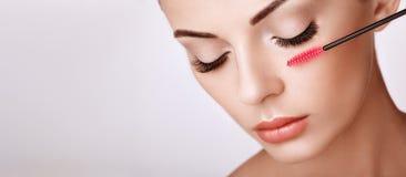 Beautiful woman with long false eyelashes stock photo