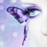 Beautiful woman eye close up with butterfly wings. And blue make up Royalty Free Stock Photo