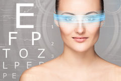 Beautiful woman with eye scanning Stock Images