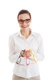 Beautiful woman in eyeglasses holding three different pair of ey Stock Images