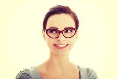 Beautiful woman in eyeglasses looking up. Royalty Free Stock Image