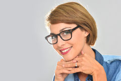 Beautiful woman with eyeglasses posing Stock Photography