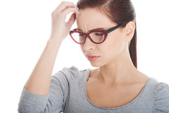 Beautiful woman in eyeglasses worrying. Royalty Free Stock Photo