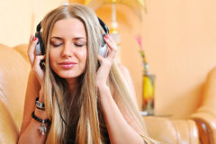 Music - beautiful woman with eyes closed in earphones - close up Royalty Free Stock Photography