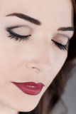 Beautiful woman eyes closed and red lips close up Royalty Free Stock Photography
