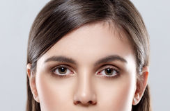 Beautiful woman eyes and nose studio on gray background Royalty Free Stock Images