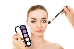 Beautiful woman with eyeshadows palette isolated. Beautiful woman with eyeshadows palette Royalty Free Stock Image