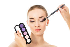Beautiful woman with eyeshadows palette isolated. Beautiful woman with eyeshadows palette Royalty Free Stock Photo
