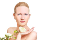 Beautiful woman face. And flower Stock Image