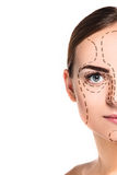 The beautiful woman face with arrows close up over white background Stock Photography