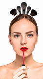 The beautiful woman face with arrows close up over white background royalty free stock image