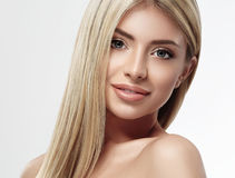 Beautiful woman face blonde hair portrait close up studio on white long hair Royalty Free Stock Photos