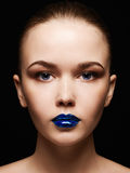 Beautiful woman face with blue lips gloss Royalty Free Stock Images