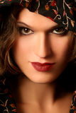 Beautiful woman face close-up. Portrait of young sensuall woman in shawl. Beautiful woman face close-up Royalty Free Stock Image