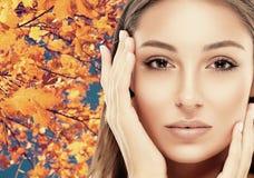 Beautiful woman face close up autumn Stock Images