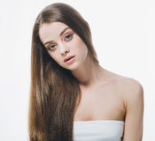 Beautiful woman face close up portrait beauty hair young studio on white Stock Photography