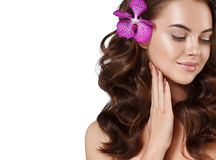 Beautiful woman face close up portrait long beautiful hair with flower young. Stock Images