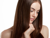 Beautiful woman face close up portrait long beautiful hair young studio on white Stock Image