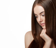 Beautiful woman face close up portrait long beautiful hair young studio on white Royalty Free Stock Images