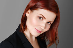 Beautiful woman face close up portrait young studio on gray Royalty Free Stock Photo