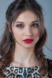 Beautiful woman face close up portrait young studio on gray. Natural beauty Royalty Free Stock Photography