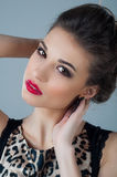 Beautiful woman face close up portrait young studio on gray. Natural beauty Stock Image