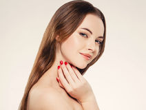 Beautiful woman face close up portrait young studio on white. Royalty Free Stock Photos