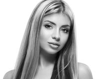 Beautiful woman face close up studio on white black and white Royalty Free Stock Photos