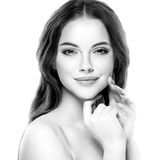 Beautiful woman face close up studio on white black and white Stock Photo