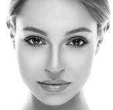 Beautiful woman face close up studio on white Stock Images